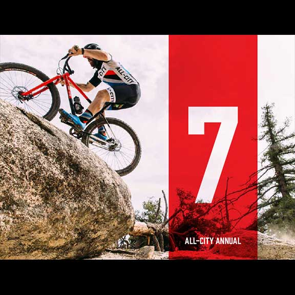 Man rides red All-City Annual Volume 7 on rocky terrain