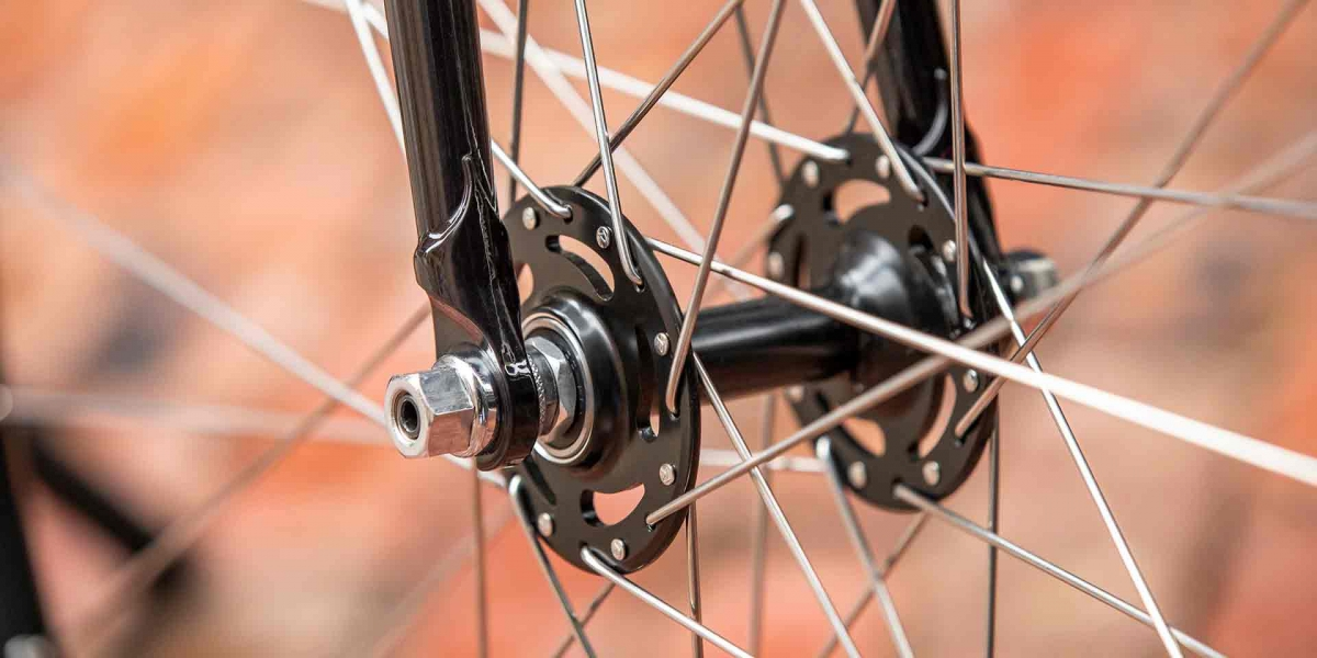 Gray and black All-City Cycles Big Block fork dropout and front hub view