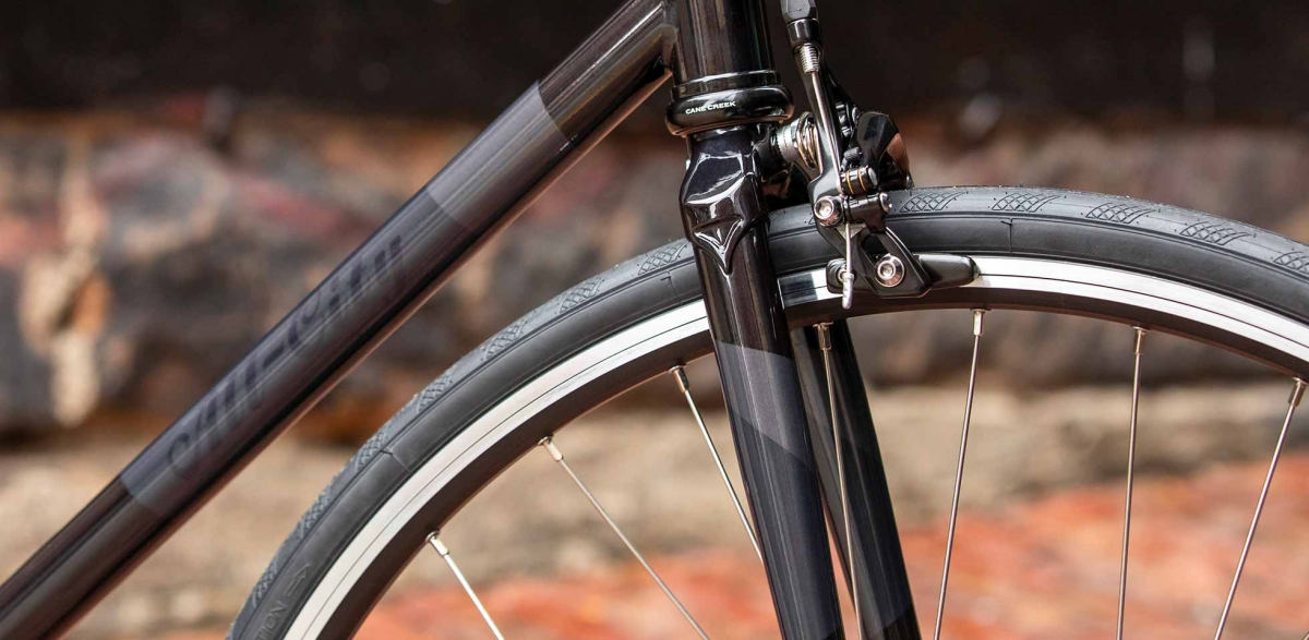 Gray and black All-City Cycles Big Block bike frame and tire view
