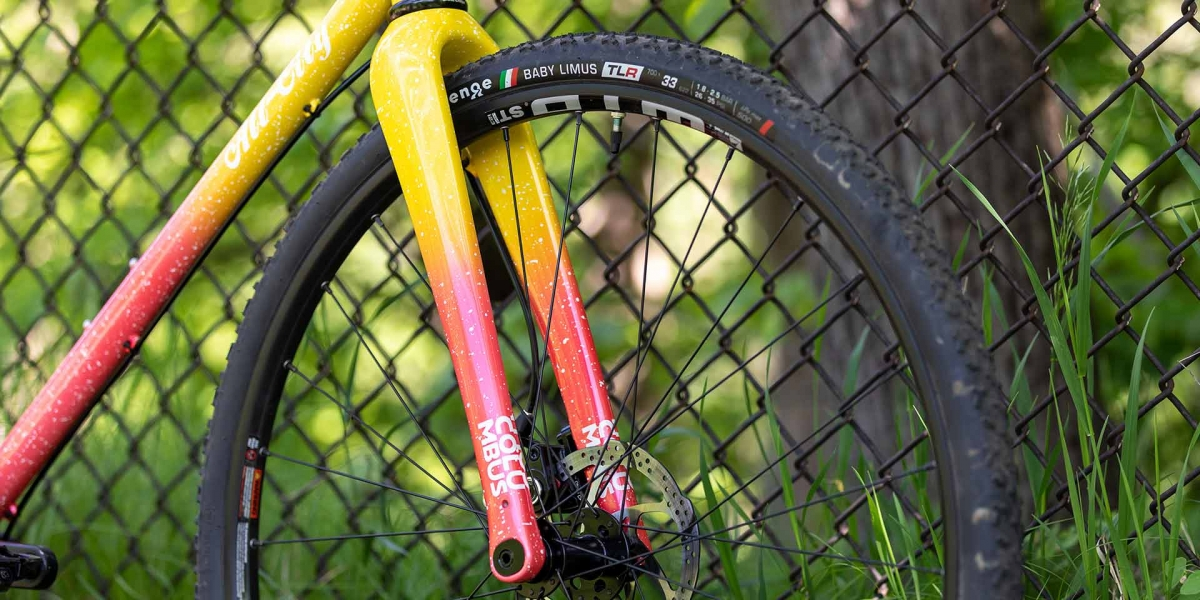 Columbus Futura Cross Carbon fork, painted to match, and front wheel of Nature Cross Single Speed Pink Lemonade bike