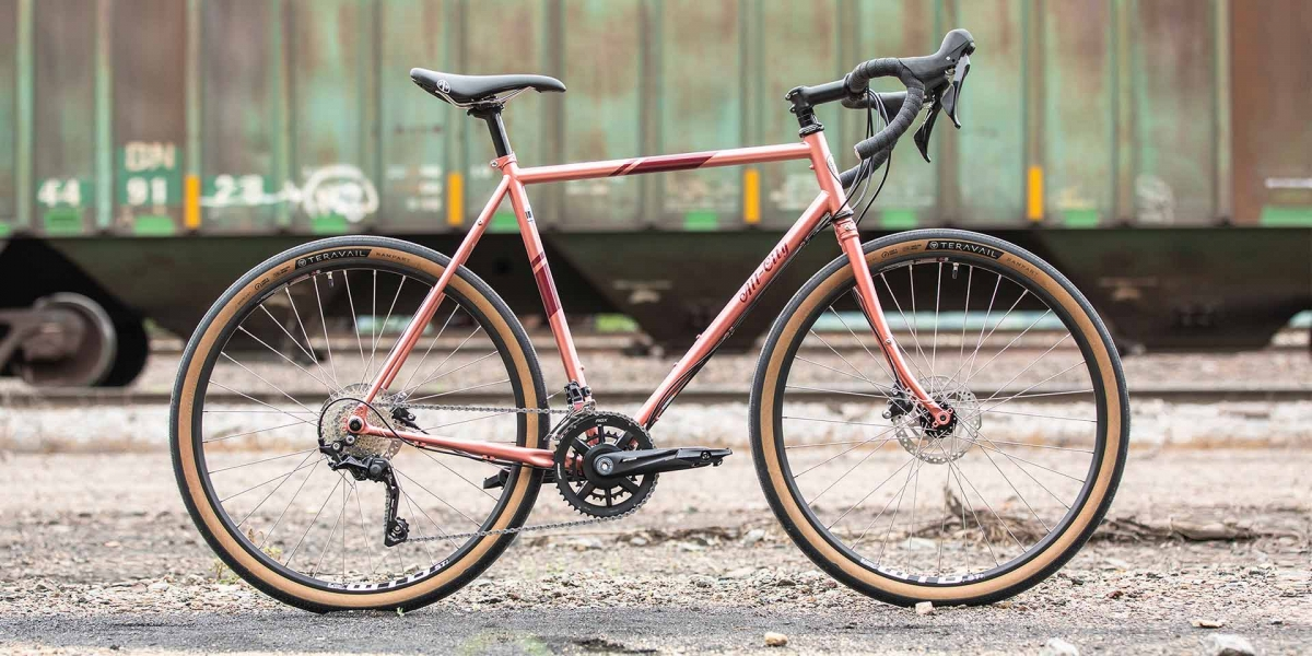 All-City Cycles Space Horse Pink Road Touring Bike full view on industrial background