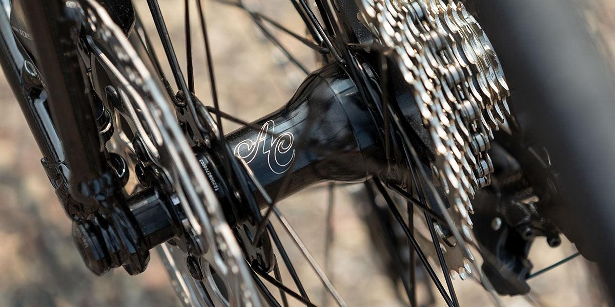 Close-up of black All-City Go Devil rear disc hub and cassette on Zig Zag 105 complete bike
