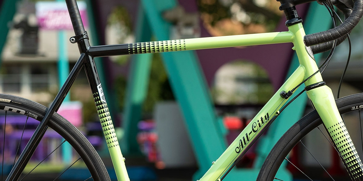 Side view close-up of green All-City Zig Zag 105 green and black complete bike showing paint design