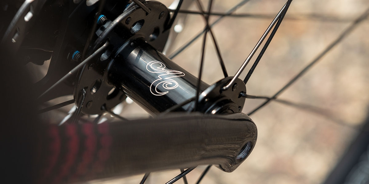 Detail of Zig Zag Ultegra carbon fork legs and black All-City Go Devil front disc hub