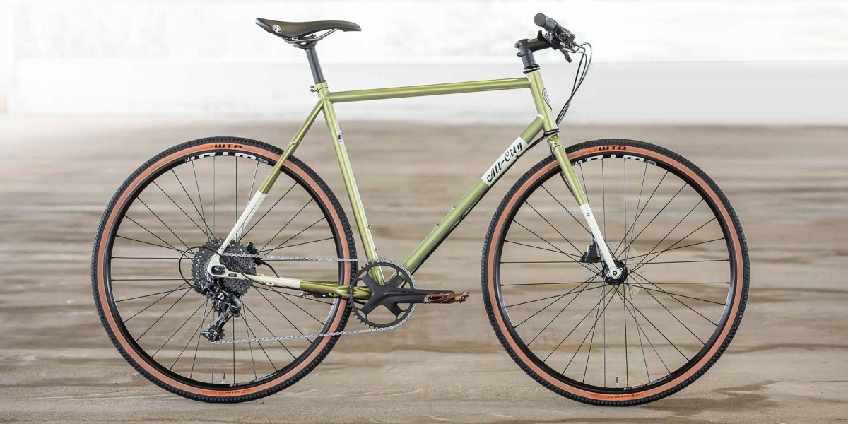 All-City Cycles Super Professional Apex 1 Flash Basil complete bike, side view on hard-wood floor