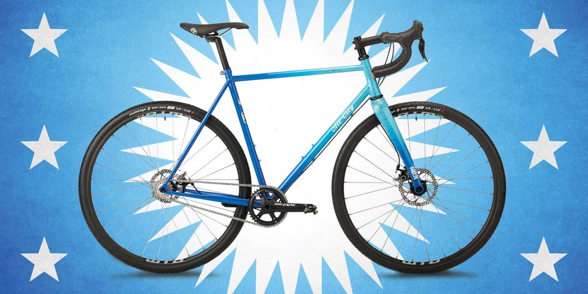 Blue All-City Nature Cross Single Speed bike full frontal view on blue and white abstract background