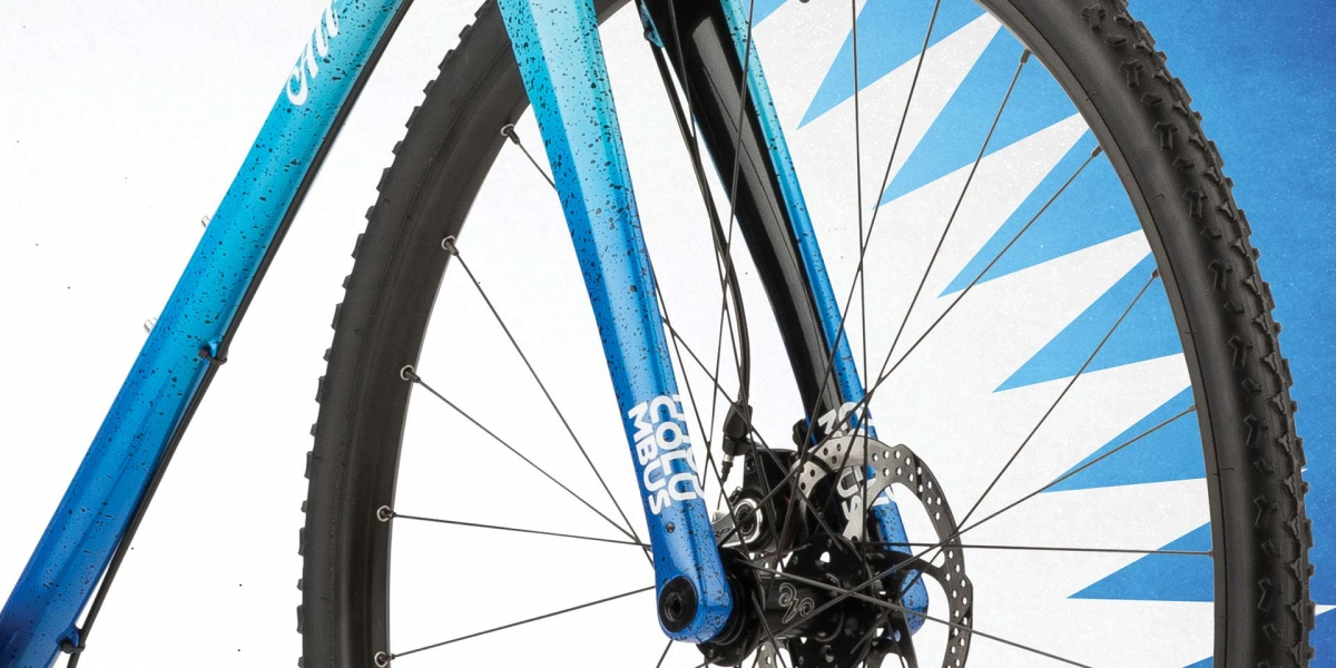 Blue All-City Nature Cross Single Speed bike wheel and frame view