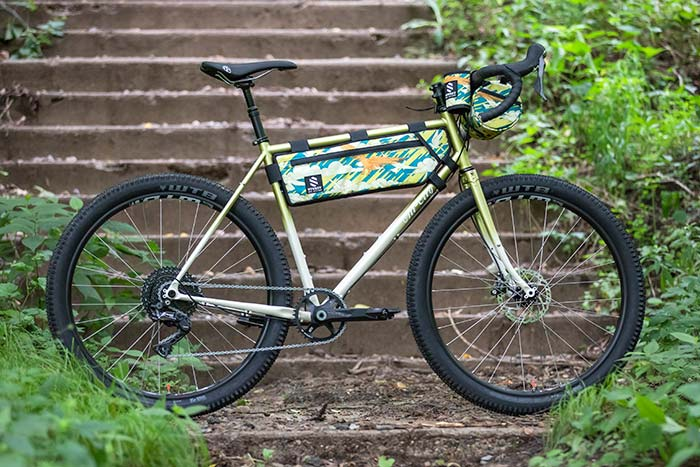 All-City Green Gorilla Monsoon GRX full bike view against outdoor background