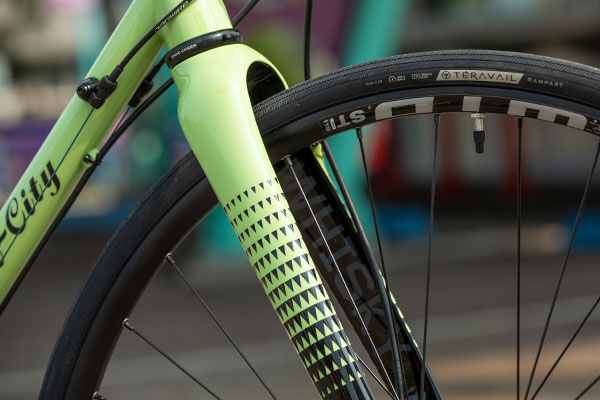 Close-up of painted to match Whisky No.9 Carbon Fork on complete Ultegra bike, Whisky logo on inside of fork leg