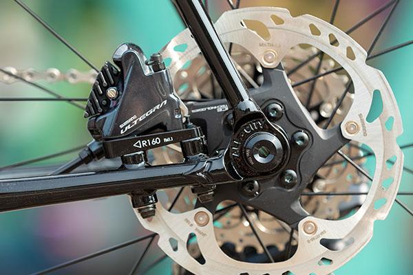 Rear dropout detail on non-drive side of Zig Zag bike showing flat mount Ultegra disc caliper mounted