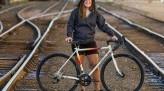Jenny Carmichael Posing with Bike on Train Tracks