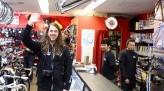 Nathan Choma waves from inside bike shop