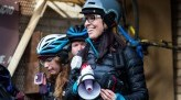 Saisha Harris wears helmet and smiles next to other riders