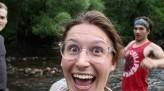 Smiling Jenny Carmichael by a lake