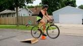 Saisha Harris jumping bike on road