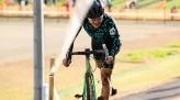 Koshi dismounting his bike getting ready to run uphill