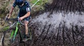 Koshi riding through a mud pit during cyclocross race