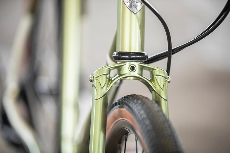 All-City Super Professional fork crown detail showing tire clearance on Apex 1 Flash Basil colorway