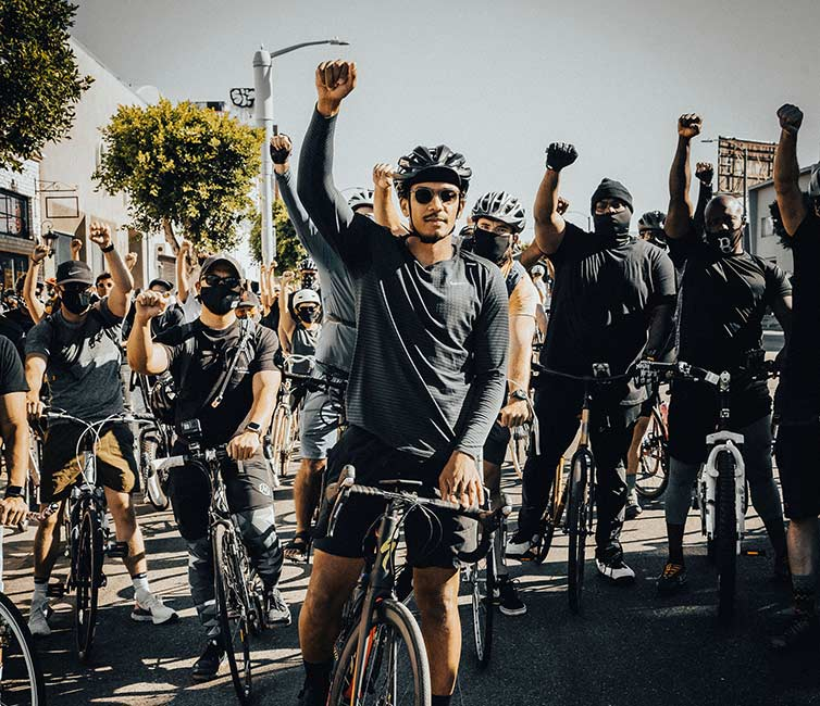 Ron Holden with fist up along with many others at Ride For Black Lives event