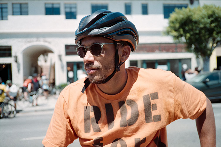 Ron Holden wearing cycling helmet and sunglasss on sunny day during Ride For Black Lives event
