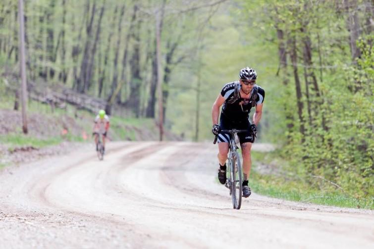 Man Biking down a dirt road