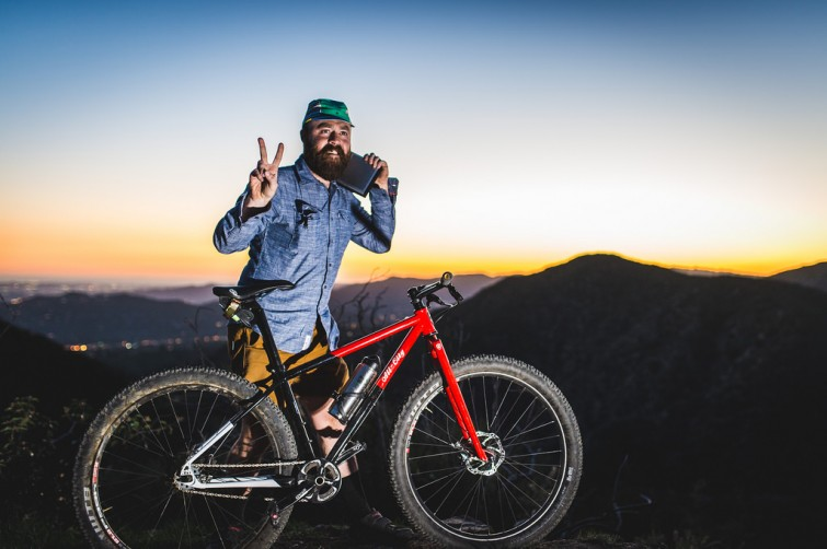 Red All State Bike and rider giving peace sign