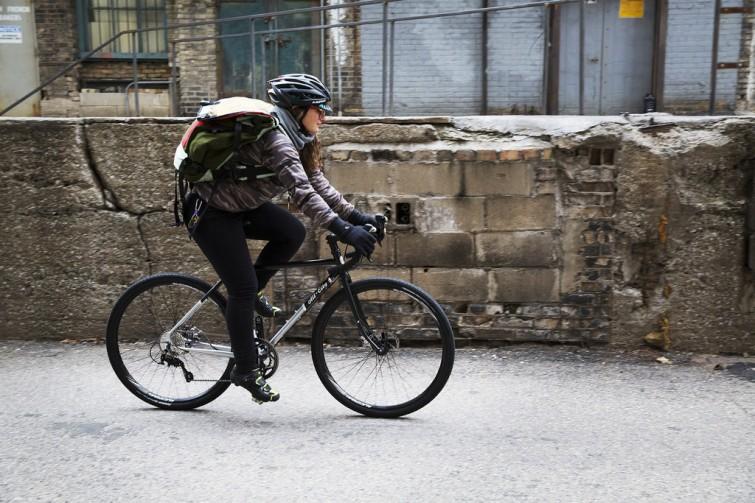 A man riding along stone wall