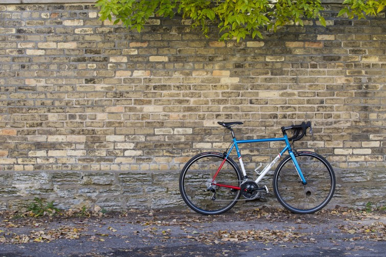 All City Bike against brick wall