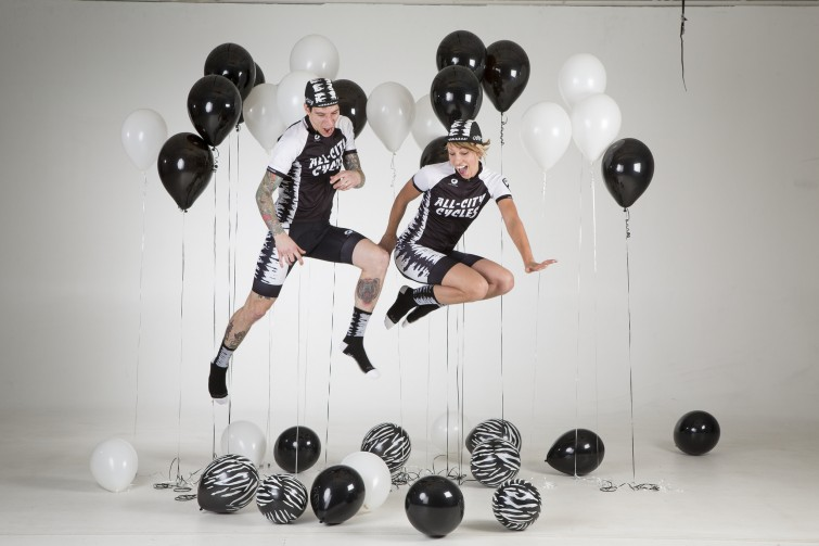 A couple among black and white balloons