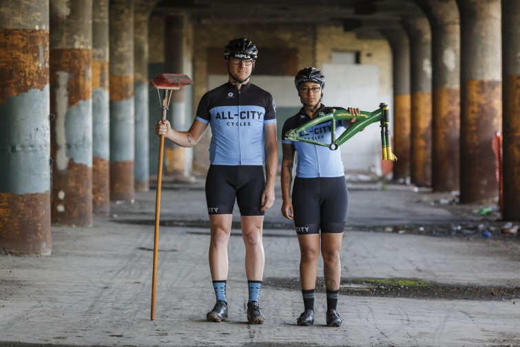 Two cyclists in industrial background
