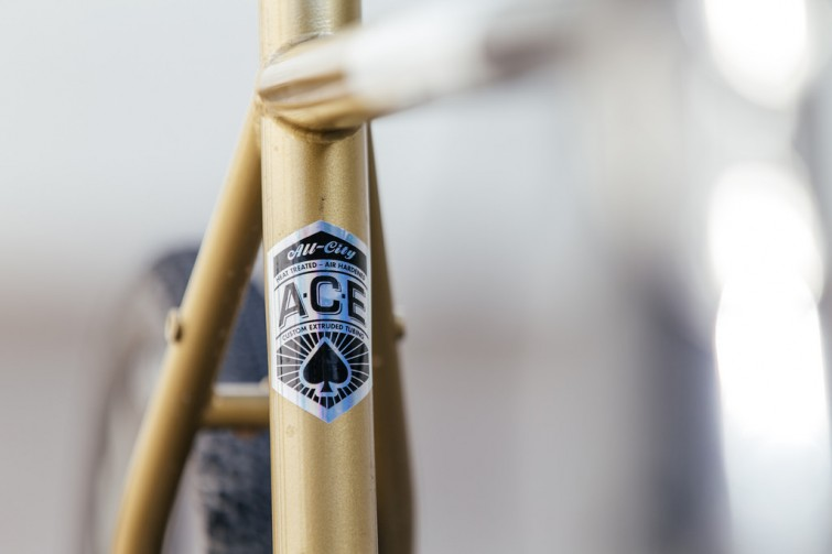A close up of a gold bike frame