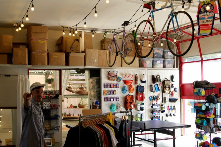 A photo of a bicycle shop with bicycles hanging from the ceiling