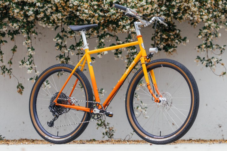 A bicycle with yellow frame