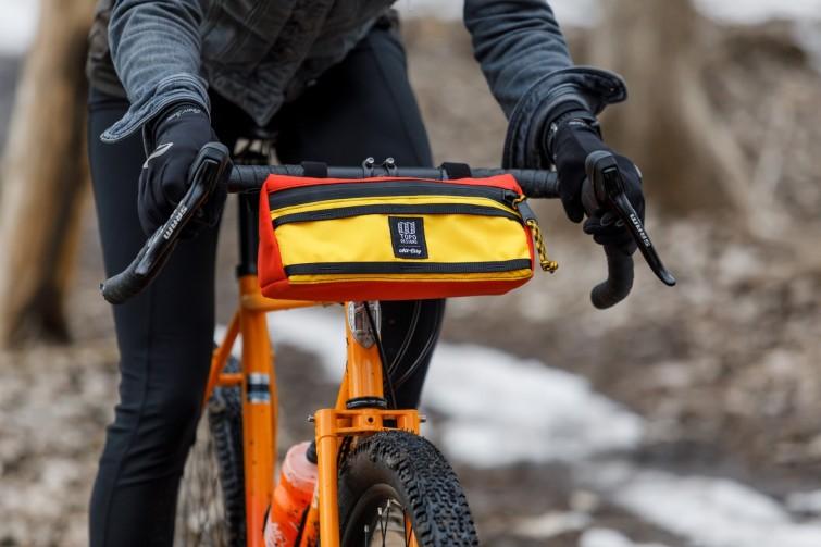 A rider and a yellow orange handlebar