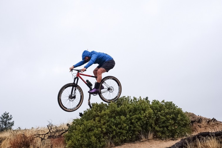 All City Bike Jumping over Mound