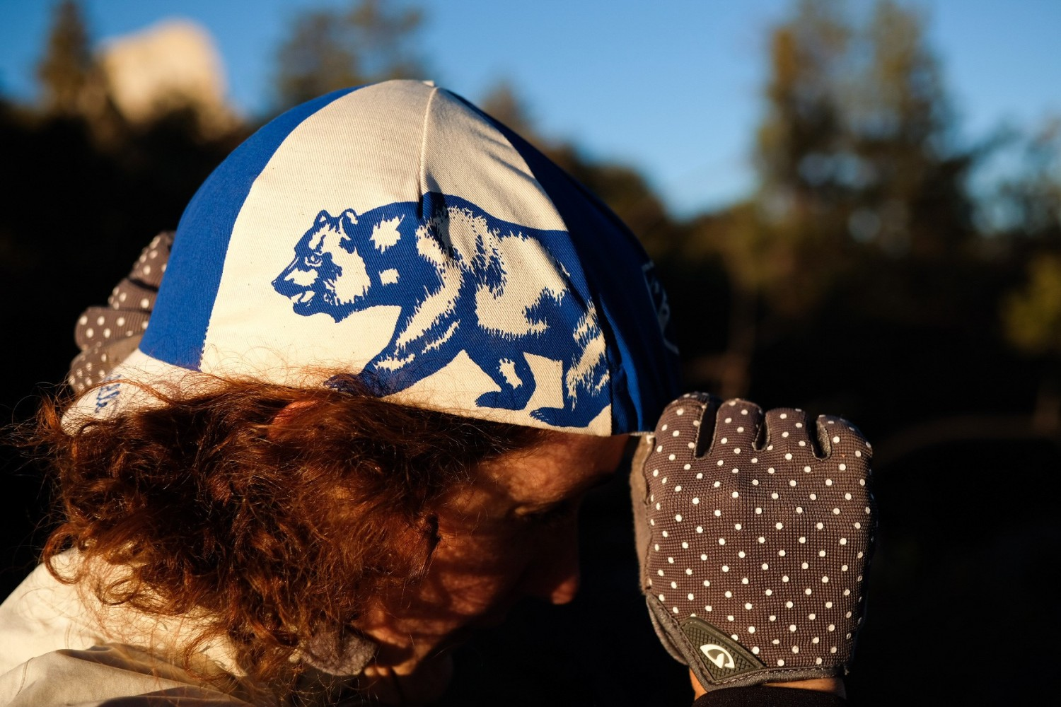 A person wearing a white with blue cap
