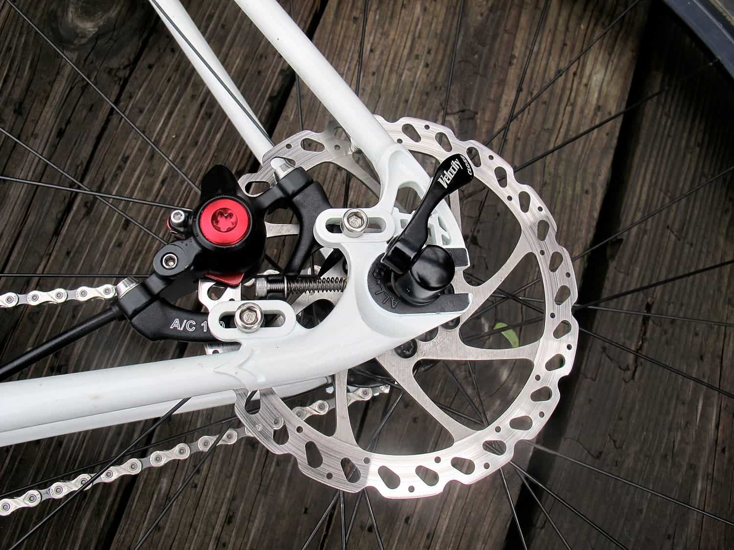 Polished silver All-City Disc Brake Adaptor on silver frame