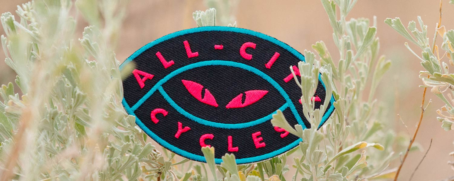 Night Claw Patch close-up showing cat eyes with All-City Cycles text around them