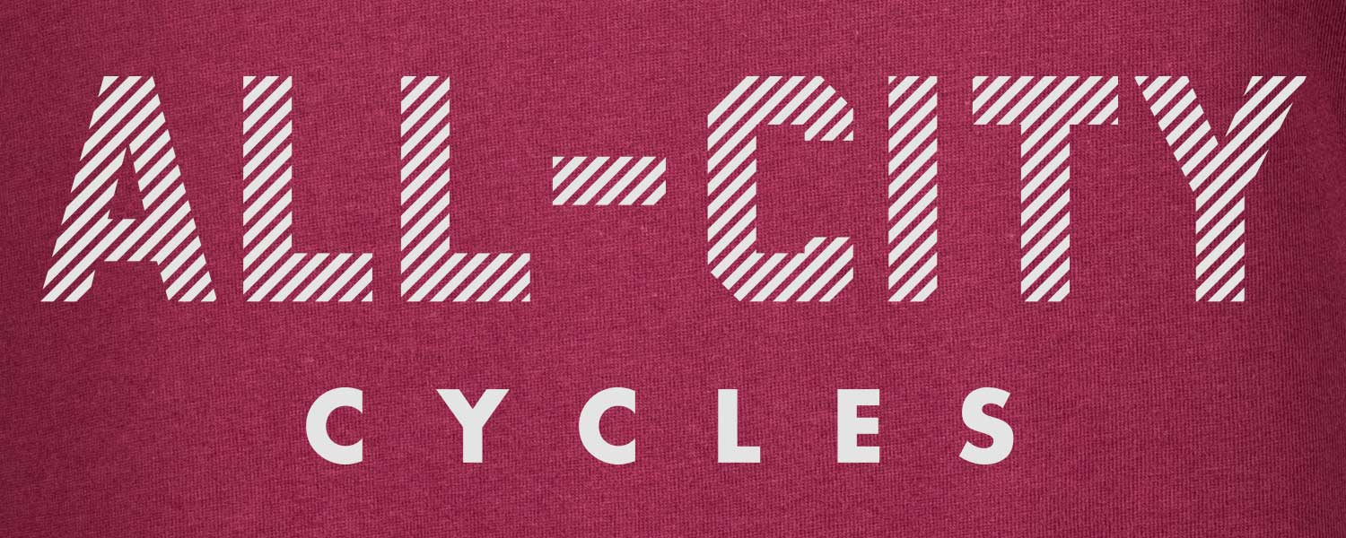 Close-up of Logowear T-Shirt, All-City Cycles block font logo on maroon color fabric