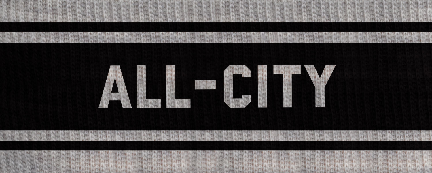All-City Logowear text design up-close, reverse copy on light gray wool with black around it