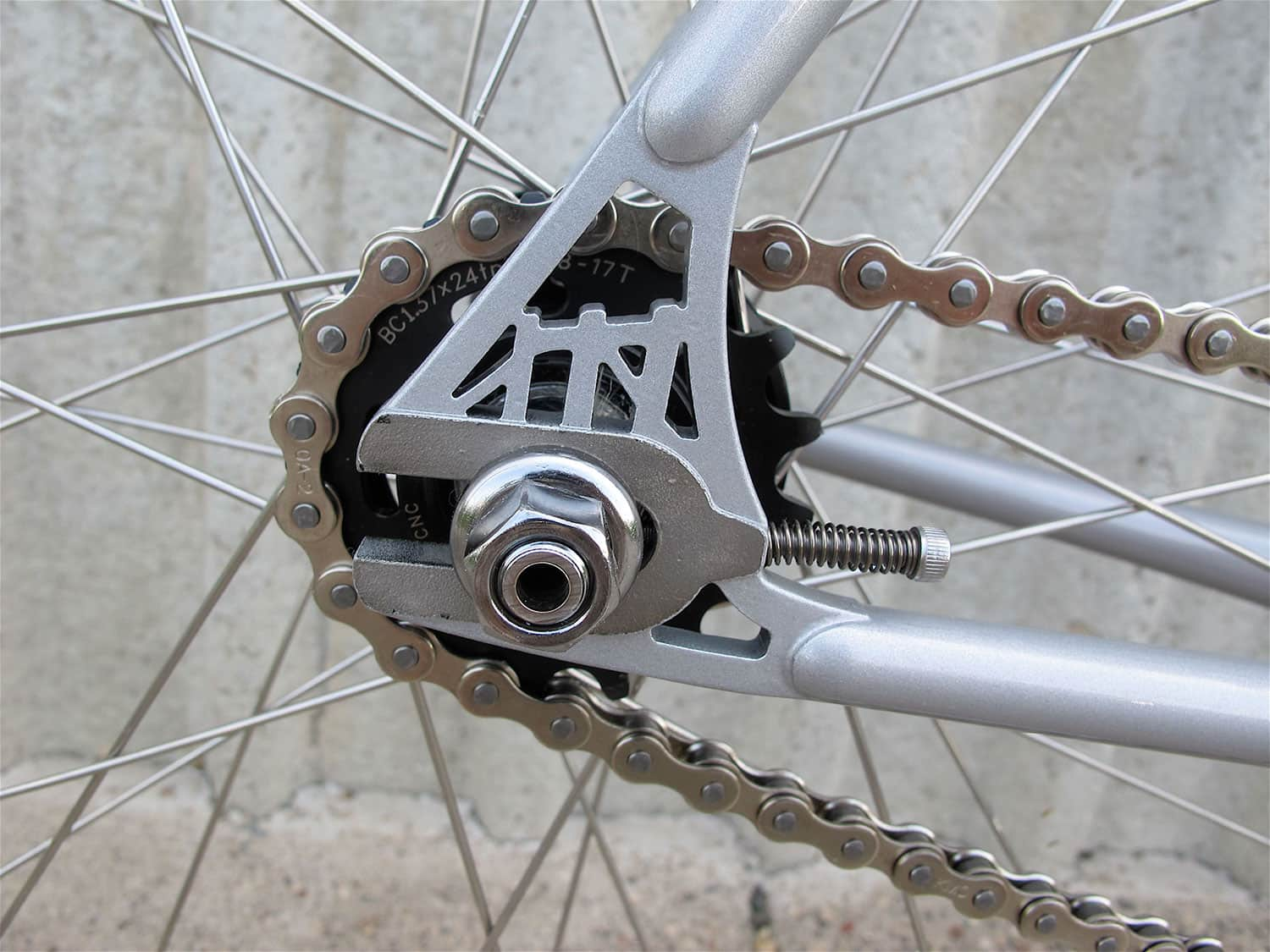 Black All-City Standard Cog on a silver bike wheel