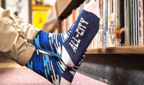Person wearing All-City Flow Motion blue wool socks with feet close up