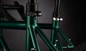 Black and polished silver All-City Shot Collars on two green bike with black background