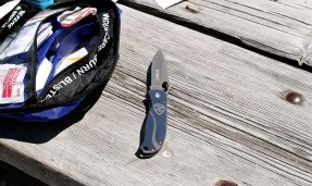 Silver All-City utility knife on wood background