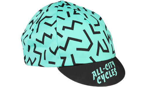 All-City Cycles teal and black Max Cycling Cap on a white background
