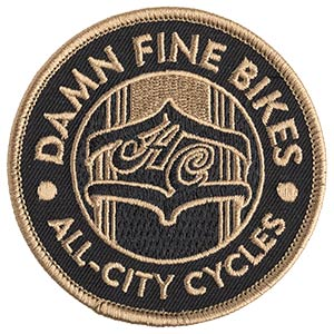 Black background, gold patch that says damn fine bikes