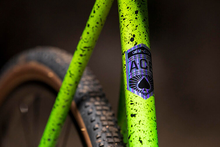 All-City A.C.E. Tubing decal on splatter painted cyclocross bike